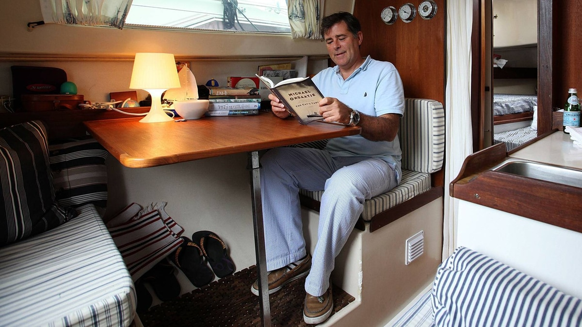 Geoffrey Taylor, artistic director of the International Festival of Authors at Harbourfront in Toronto, loves to read at the table on his 26-foot sailboat.