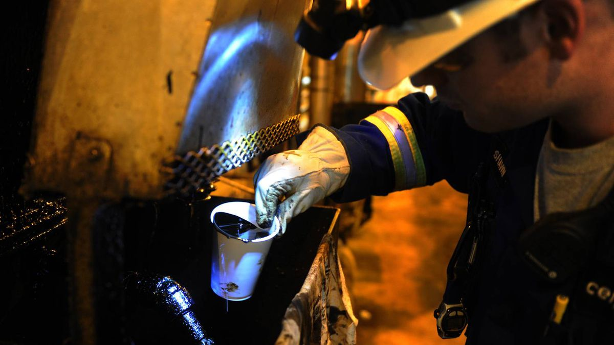 A worker analyzes oil cut samples at Cenovus's Christina Lake operation north of Fort McMurray, Alta.