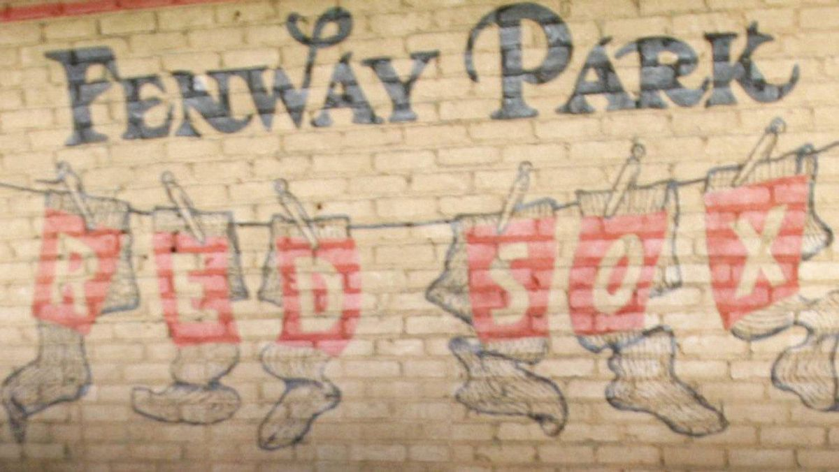 A hand painted sign at Fenway Park as Fenway Park commemorates it's 100th year anniversary in Boston, Massachusetts April 20, 2012. REUTERS/Jessica Rinaldi