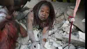 A Haitian woman is covered in rubble in Port-au-Prince. Daniel Morel/AFP/Getty Images