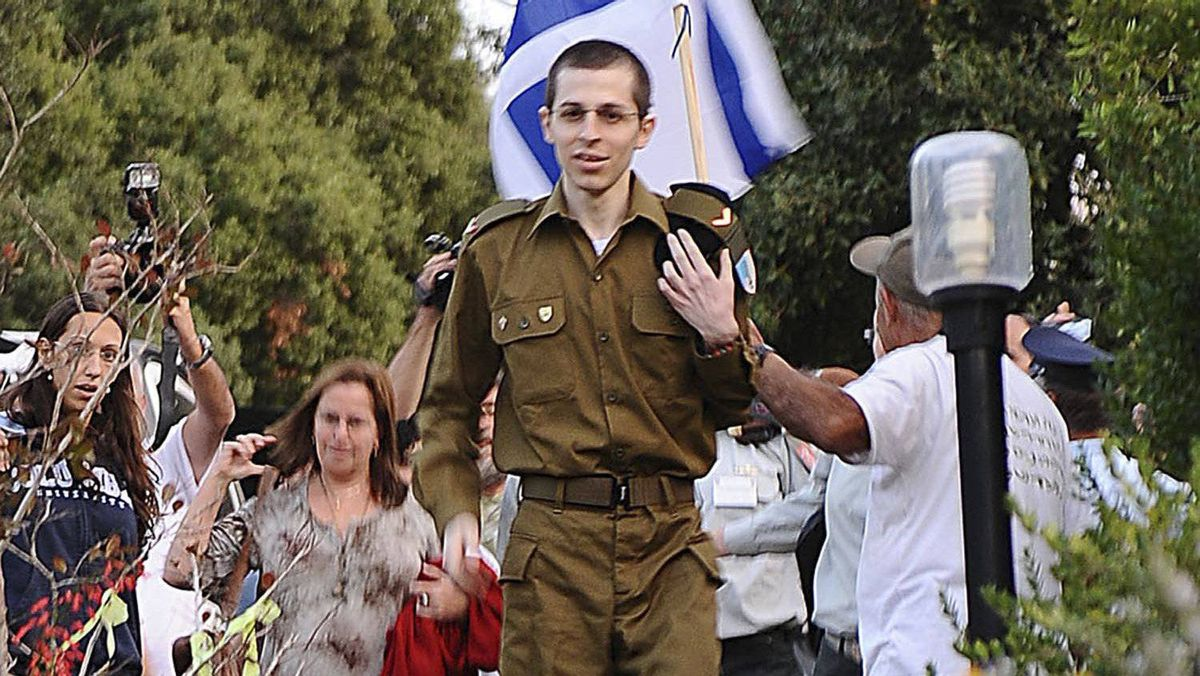 Sgt. Gilad Shalit arrives at his home in the northern village of Mitzpe Hila in this handout released by the Israeli Defence Forces on Oct. 18, 2011.