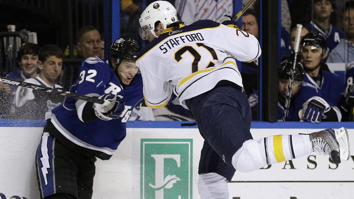 Tampa Bay Lightning defenseman Matt Smaby (32) takes Buffalo Sabres right wing Drew Stafford (21) off his feet during the first period of an NHL game Saturday, Dec. 18, 2010, in Tampa, Fla. The Bolts won 3-1. (AP Photo/Chris O'Meara)