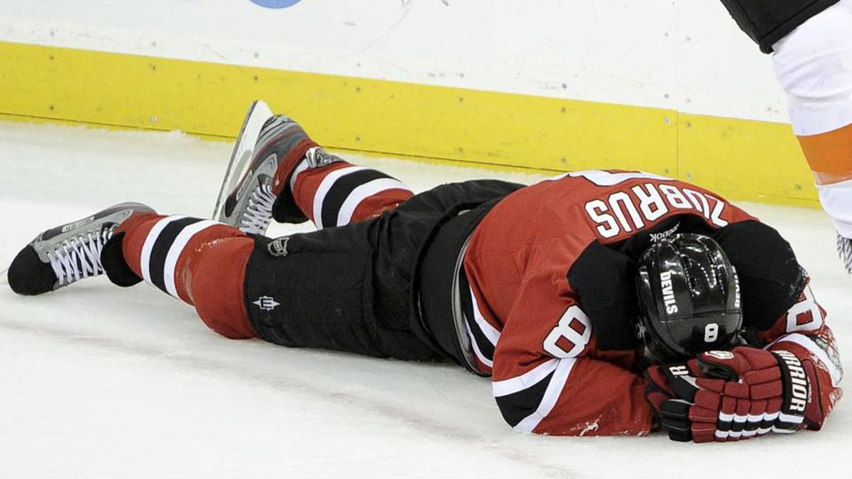 New Jersey Devils' forward Dainius Zubrus lies on the ice after being hit by Philadelphia Flyers' Claude Giroux during the second period in Game 4 of their NHL Eastern Conference semi-final playoff hockey game in Newark, N.J.