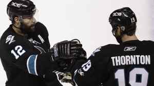 San Jose Sharks center Patrick Marleau (12) is congratulated by center Joe Thornton (19) after scoring past the Vancouver Canucks during the first period of Game 3 of the NHL Stanley Cup playoffs Western Conference final hockey series Friday, May 20, 2011, in San Jose, Calif. (AP Photo/Paul Sakuma)