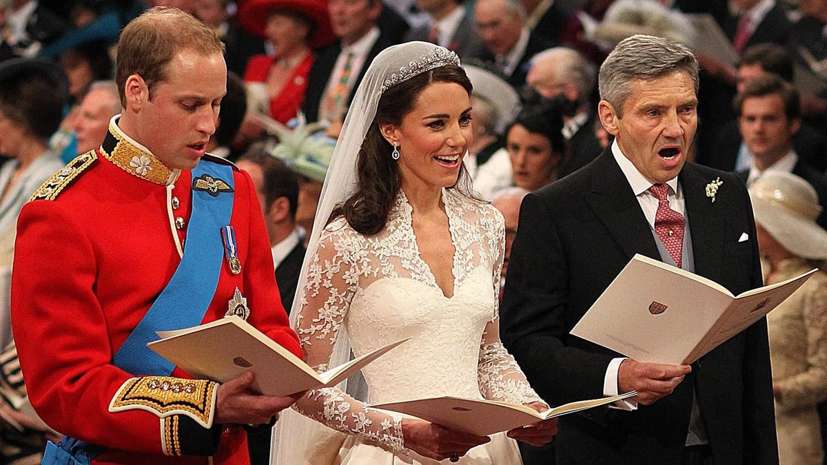 Prince William sings beside his bride Catherine Middleton and her father Michael Middleton on April 29, 2011 in London, England.