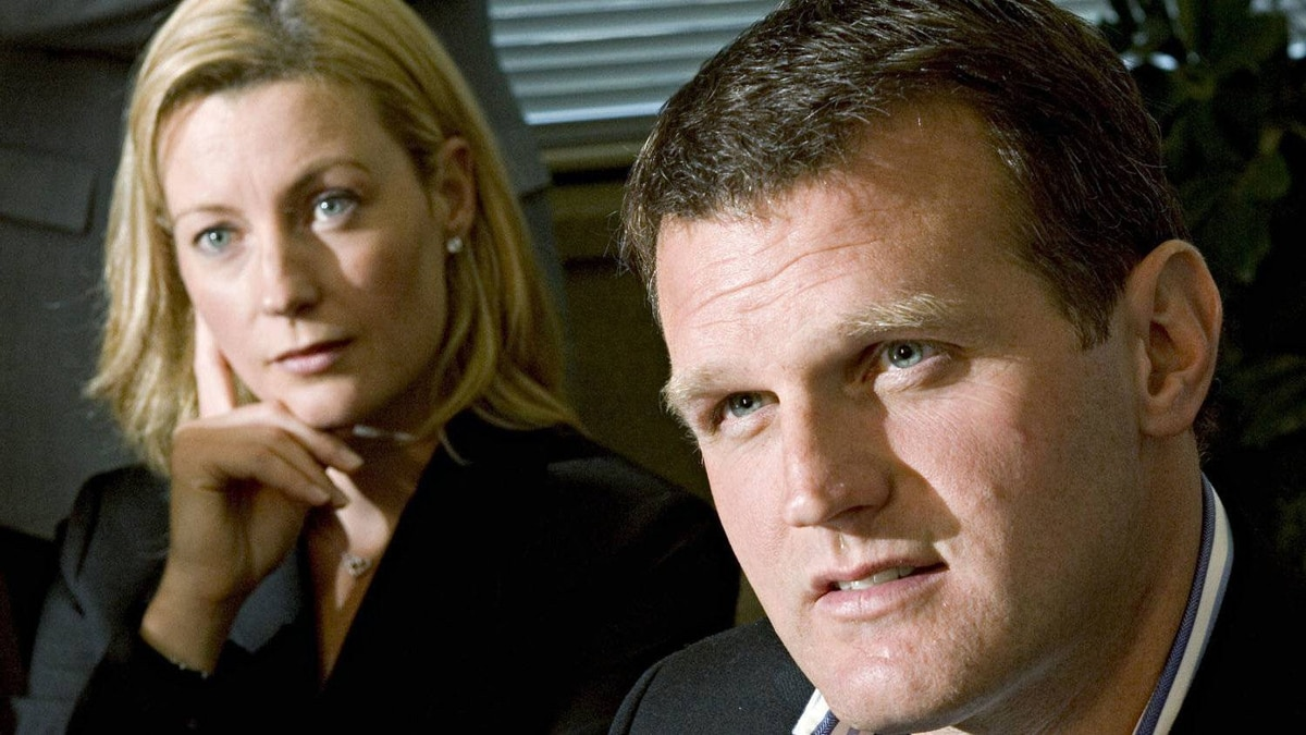 Vincent Damphousse speaks during his retirement announcement as his wife Allana listens, during a news conference on Sept. 7, 2005 in Laval, Que. THE CANADIAN PRESS/Paul Chiasson
