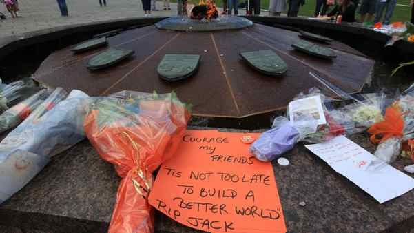 Messages, flowers and other mementos are left at the Centennial Flame as people pay tribute to NDP leader Jack Layton, on Aug. 22, 2010, on Parliament Hill in Ottawa, where a makeshift memorial has been forming after Mr. Layton died early Monday.