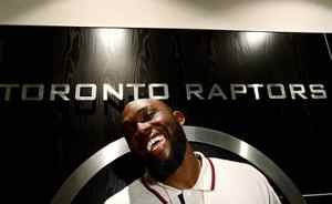 Newly acquired Toronto Raptors forward Reggie Evans smiles as he talks with the media in Toronto on Tuesday, June 16, 2009.