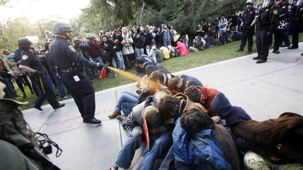 Lt. John Pike is shown using pepper spray on Occupy UC Davis protesters at the University of California, Davis on Friday, Nov. 18, 2011.