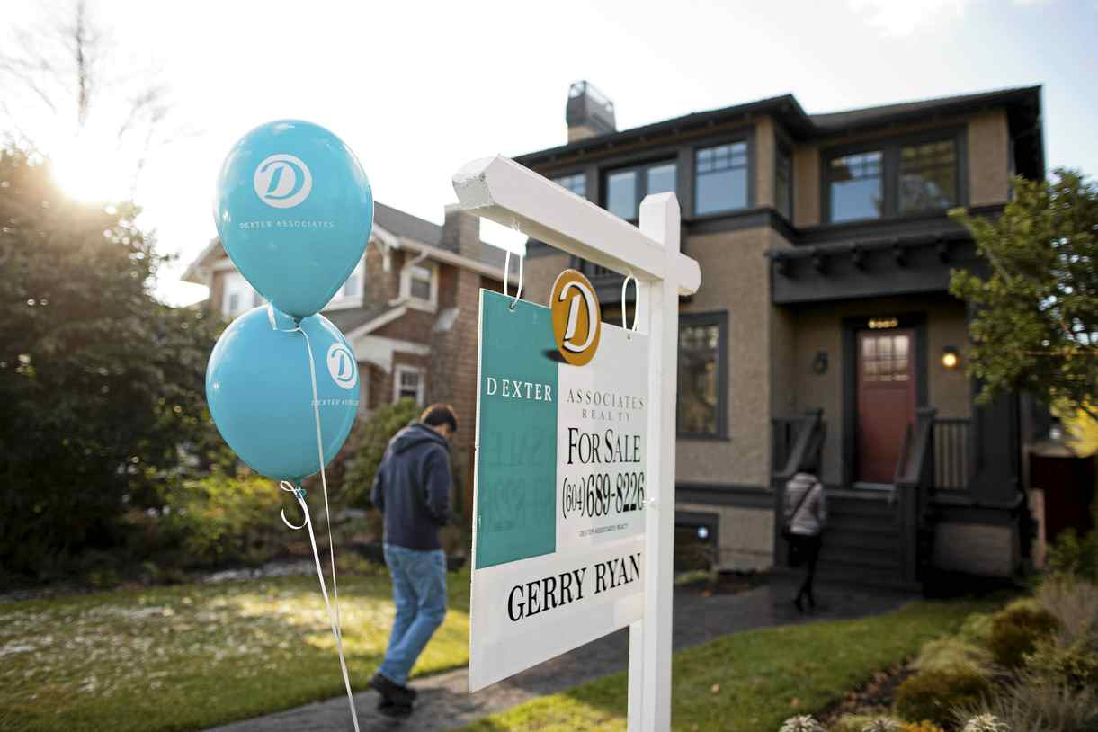 Potential purchasers make their way into an open house in the Kerrisdale neighbourhood of Vancouver, British Columbia, Sunday, January 15, 2012.