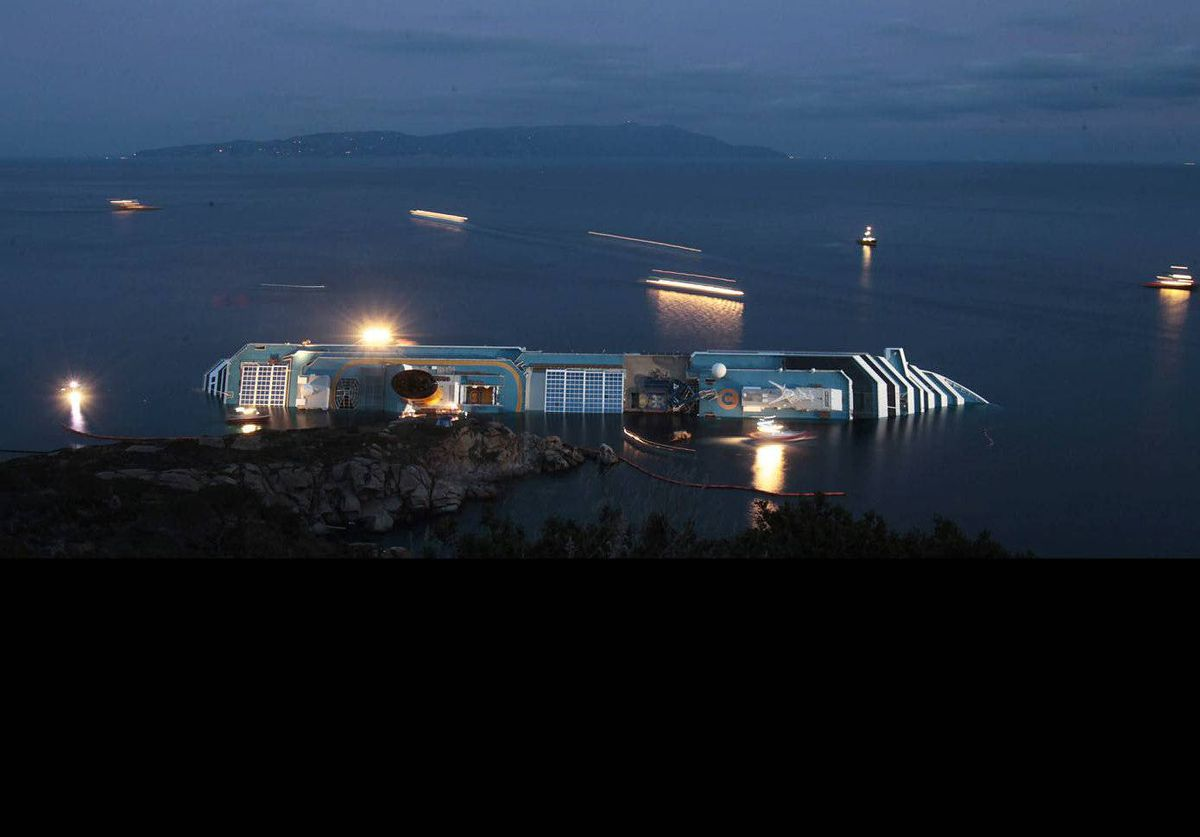 A night view of the cruise ship Costa Concordia lying on its side off the Tuscan island of Giglio, Italy. Eleven people have been confirmed dead and 21 others are still missing.