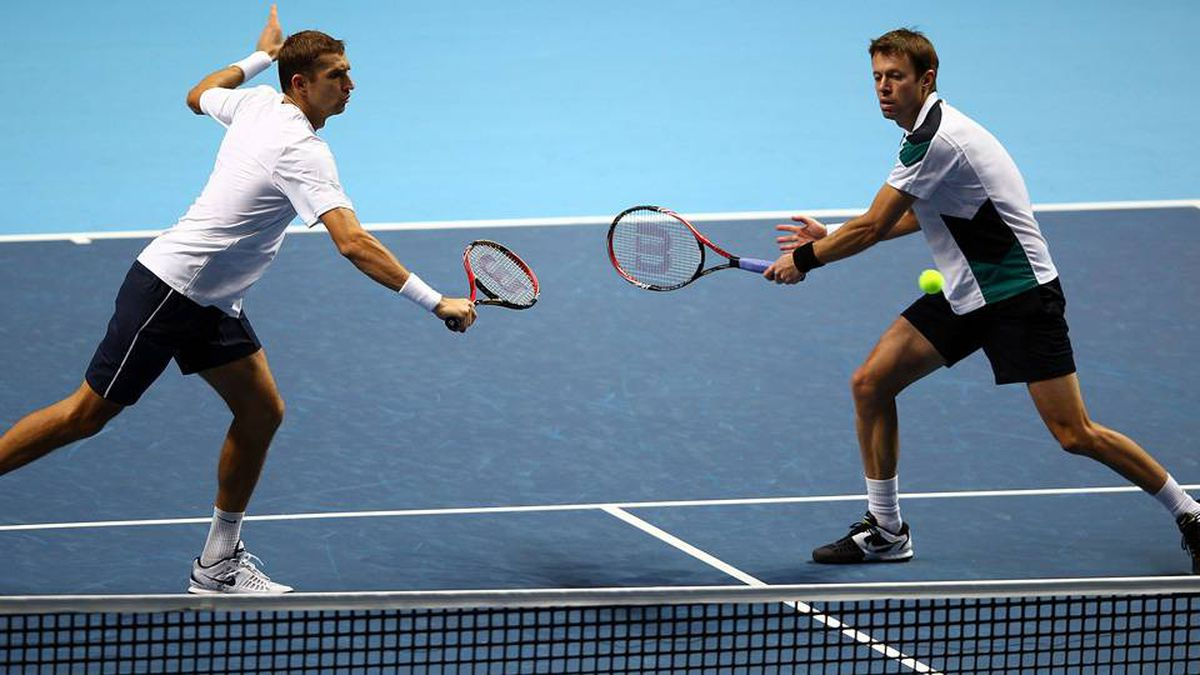 Daniel Nestor of Canada, right, returns the ball next to Max Mirnyi of Belarus during their men's doubles first round match against Rohan Bopanna of India and Aisam-Ul-Haq Qureshi of Pakistan during the Barclays ATP World Tour Finals at the O2 Arena on Sunday in London, England.