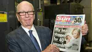 In this photo provided by News International (NI Group Ltd.) taken on Saturday Feb. 25, 2012, News Corporation Chairman and CEO Rupert Murdoch holds the first edition of The Sun on Sunday as it comes off the presses at Broxbourne, England.