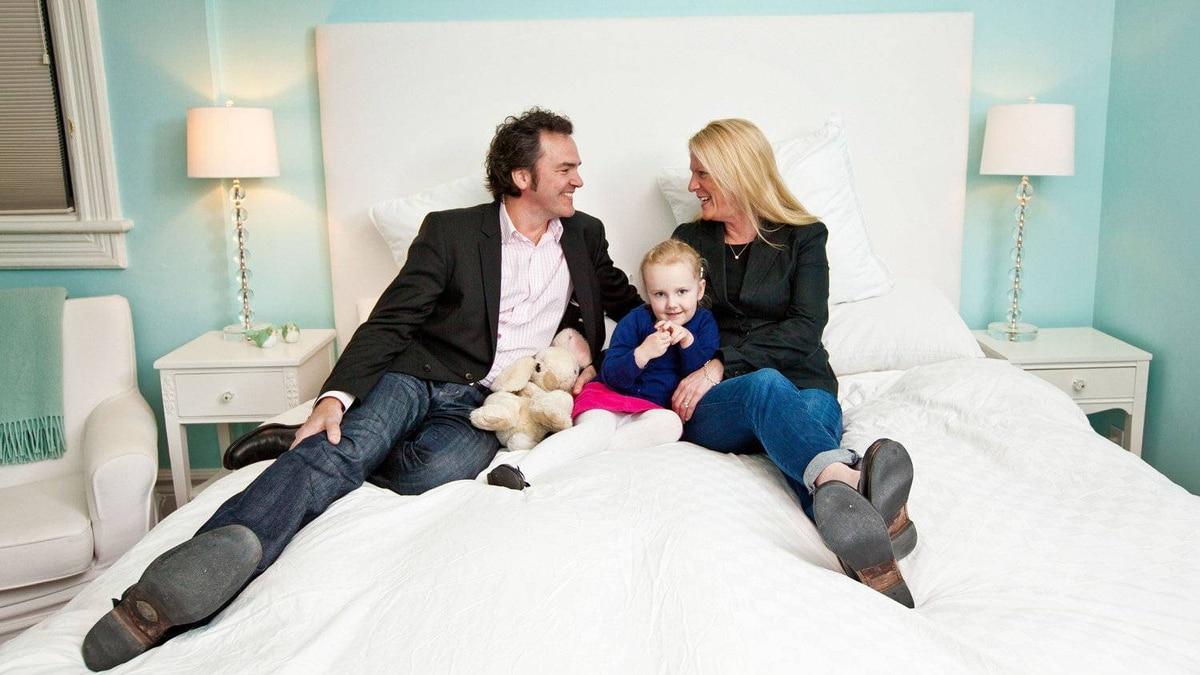 Carl Swanston, Neala Swanston, 4, and Sarah Cashman in their Toronto home.