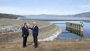 B.C. Premier Gordon Campbell, right, and Brad Bennett, grandson of W.A.C. Bennettt stand in front of the W.A.C. Bennett Dam in Hudson's Hope, B.C. Monday, April 19, 2010. Premier Campbell was in the area to announce the building of a new hydroelectric project named the Site C Clean Energy Project. Site C will use much of the same reservoir and will provide 900 megawatts of capacity and 4,600 gigawatt hours of electricity each year.