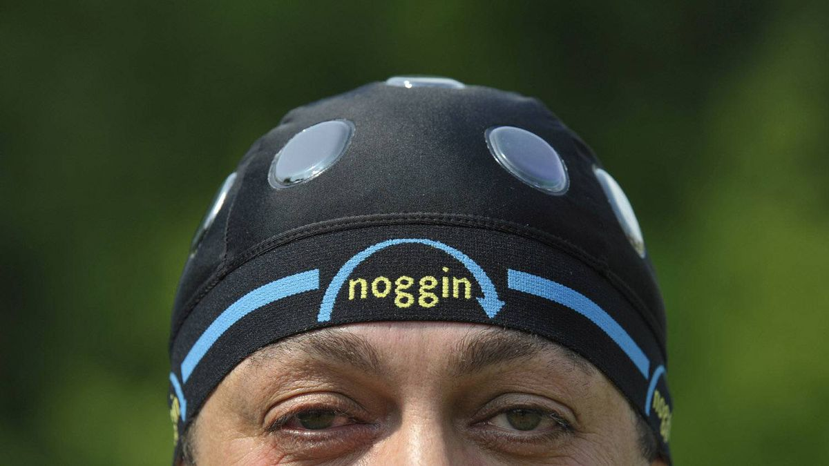 Noggin inventor Armando Pagliari wears the helmet undergear that features shock reducing gelpacks outside his home in Milton, May 25, 2012.