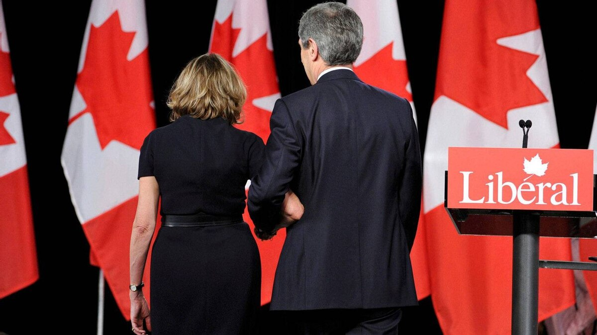 Liberal leader Michael Ignatieff and his wife Zsuszanna Zsohar leave the stage after addressing supporters following his defeat, at the Canadian federal election night headquarters in Toronto, May 2, 2011.