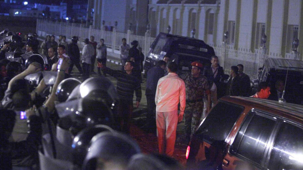Egyptian police officers guard a convoy carrying former president Hosni Mubarak's sons Alaa and Gamal outside Sharm el-Sheikh courthouse.