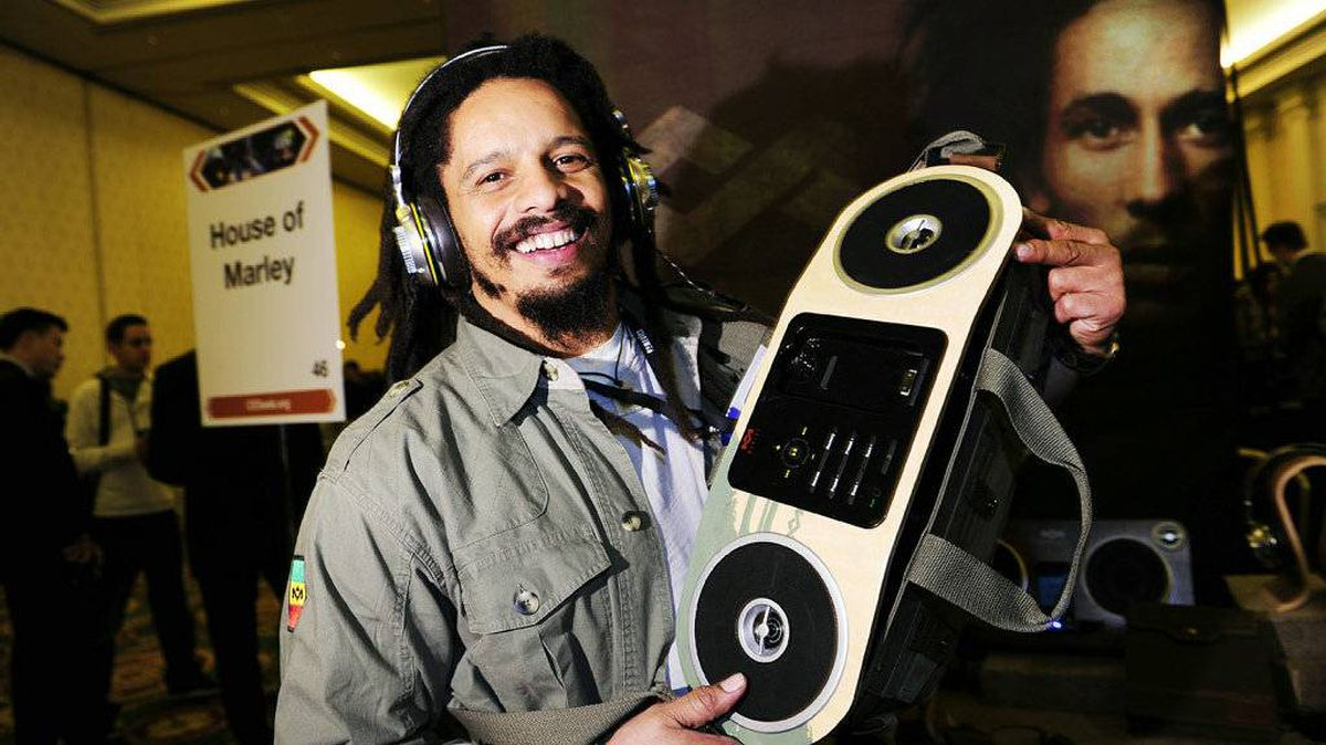 "Rohan Marley, son of late reggae musician Bob Marley, displays a Marley Jammin' Roots Rock Speakerbag featuring an FM radio and a docking station for iPhones and iPods from House of Marley while wearing the company's Marley Destiny Trenchtown Rock headphones on press preview day at the 2011 International Consumer Electronics Show January 4, 2011 in Las Vegas, Nevada. The company says it emphasizes ""Bob Marley's vision of one love, one world through eco-conscious products."" CES, the world's largest annual consumer technology tradeshow, runs from January 6-9 and is expected to feature 2,700 exhibitors showing off their latest products and services to about 126,000 attendees."
