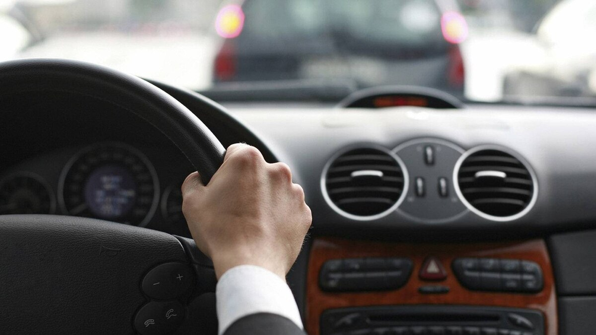 A driver steers a steering wheel. The B.C. government is changing the way it assesses the driving skills of seniors, including allowing elderly drivers to take a road test if they fail a computer assessment.