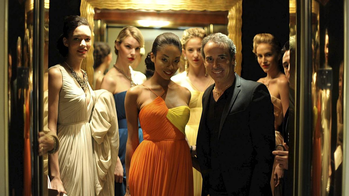 Designer Lloyd Klein, right, is seen backstage with models at the Lloyd Klein Couture fashion presentation during the Guild of Big Brothers Big Sisters Spring Luncheon and Fashion Show at the Beverly Hills Hotel on March 25, 2011 in Beverly Hills, California.