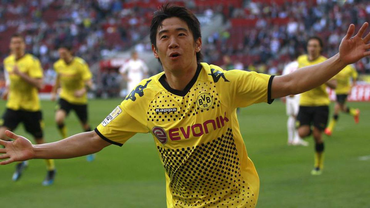 Borussia Dortmund's Shinji Kagawa celebrates a goal against Cologne during the German first division Bundesliga soccer match in Cologne on Sunday.