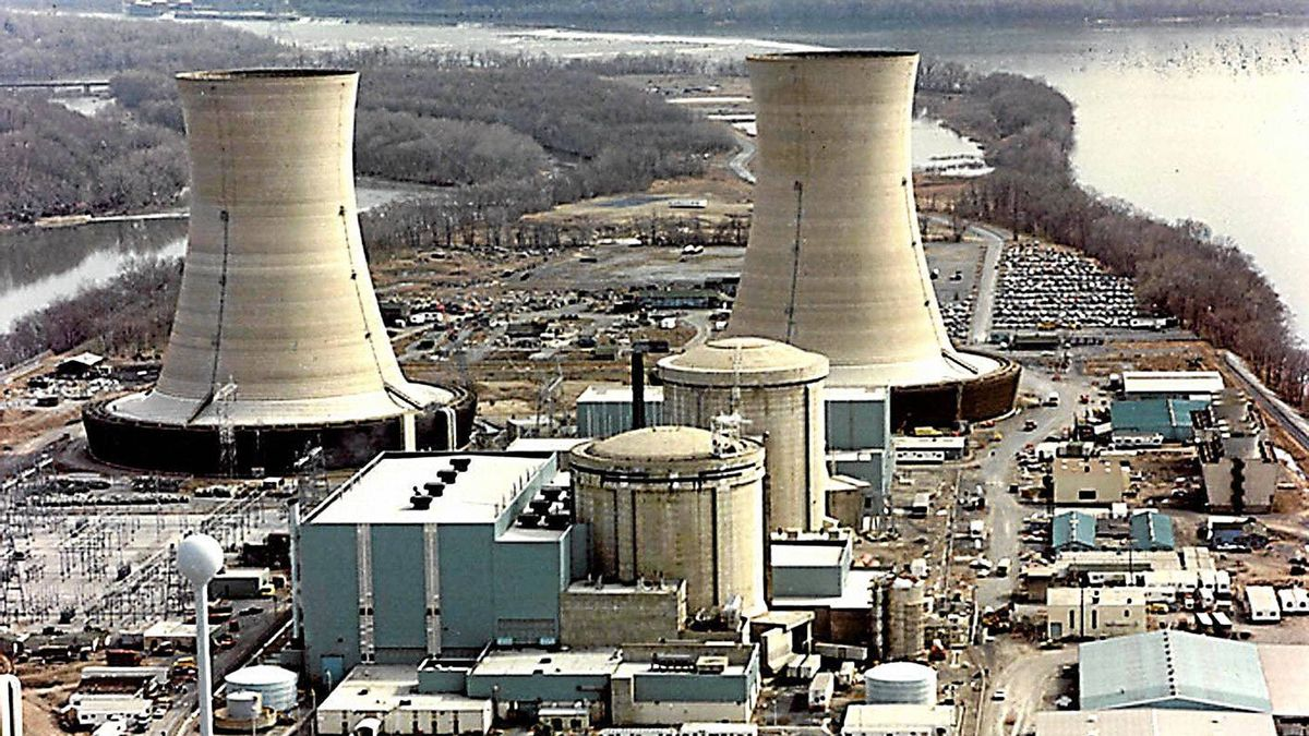 This undated US Department of Energy file photo shows two containment buildings (center) and two of the cooling towers (background) at the Three Mile Island Nuclear Power Plant in Pennsylvania.