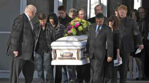 Pallberarers carry the casket at Tabitha Stepple's funeral at the Evangelical Free Church in Lethbridge, Alta., on Wednesday.