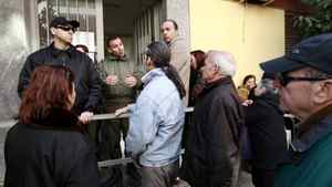 People line up outside a Social Welfare office, in order to advance their procedure to take a welfare allowance, at Egaleo suburb in the west of Athens February 17, 2012.