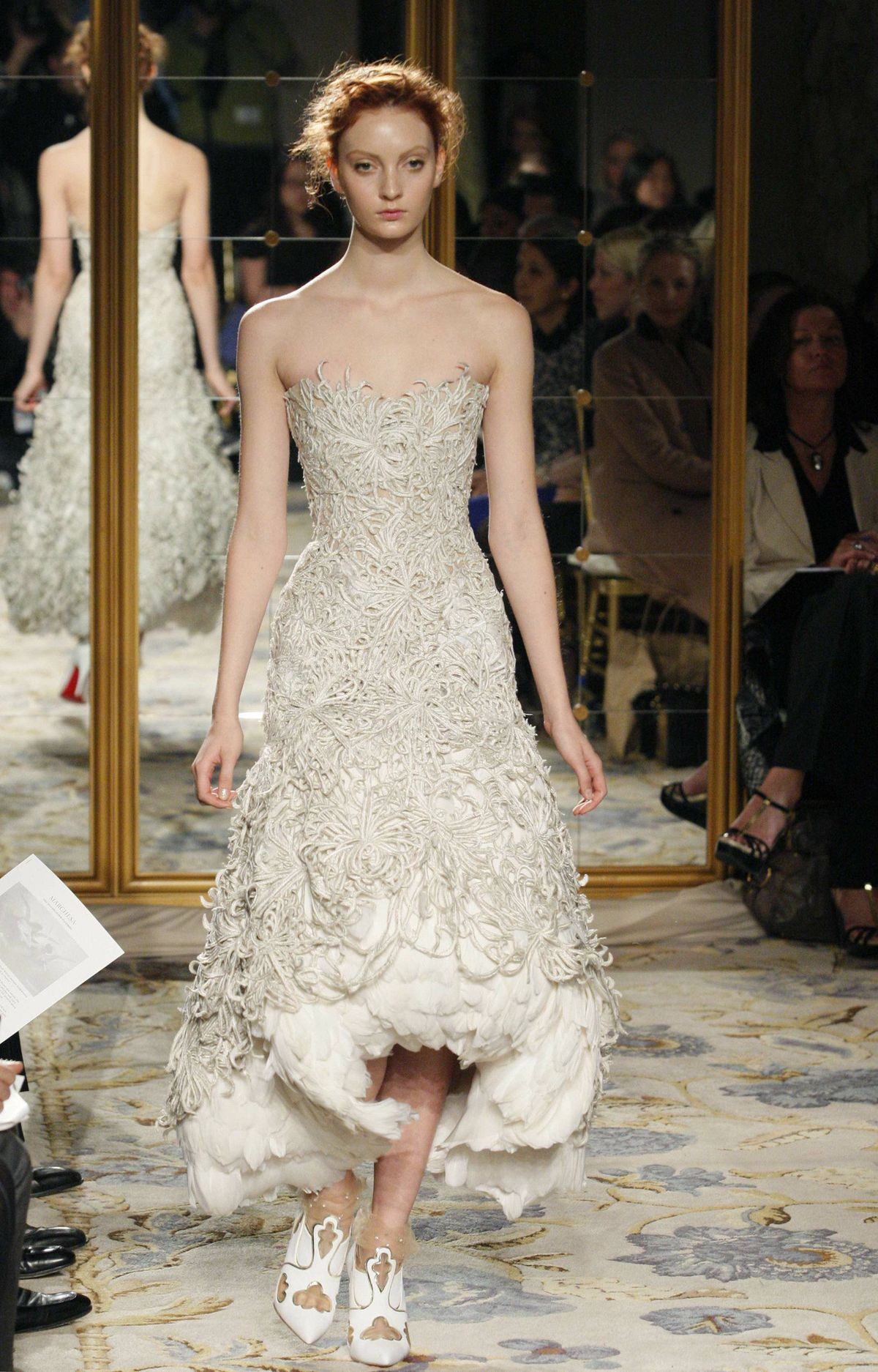 There was a lot of Alexander McQueen in this Marchesa collection; gold painted feathers, capped sleeve bodices, skeletal detailing. But all pleasure no pain.