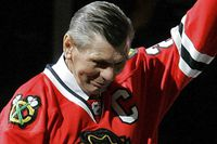Chicago Blackhawks great Stan Mikita waves to fans as he is introduced before an NHL hockey game against the San Jose Sharks in Chicago, Friday, March 7, 2008. The long-estranged Hall of Famer was named ambassador to the team and were honored in front of a sold-out crowd. (AP Photo/Brian Kersey)