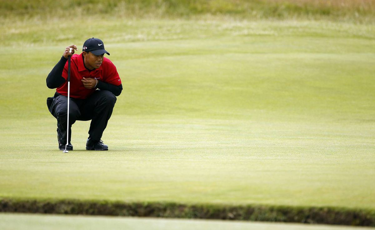 Tiger Woods lines up a putt on the 1st Green during his final round on day four of the British Open