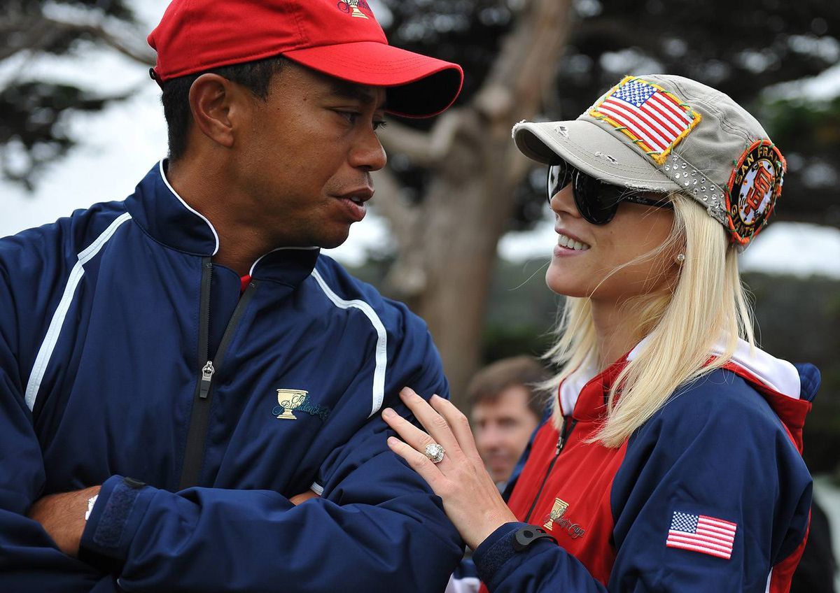 Tiger Woods and his wife Elin Nordegren talk on the golf course at the Presidents Cup golf compeititon in this October 11, 2009 file photo at Harding Park Golf course in San Francisco, Calif.