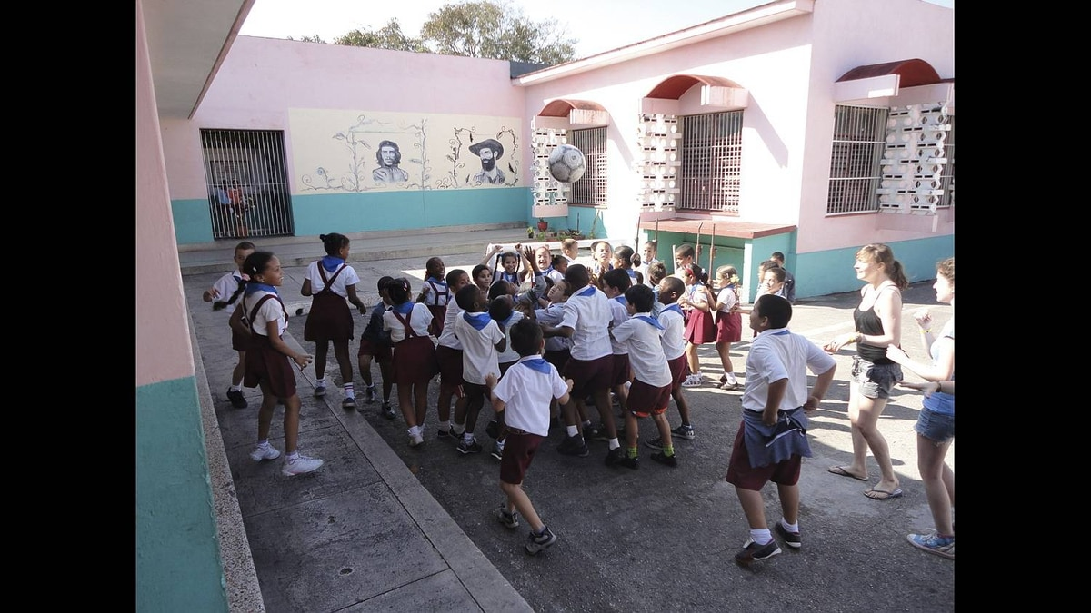 Paula Waatainen photo: Havana good time - Cuban school children rush to play with a new inflatable soccer net and ball, part of a donation of school supplies collected and delivered by students from Rockridge Secondary in West Vancouver.