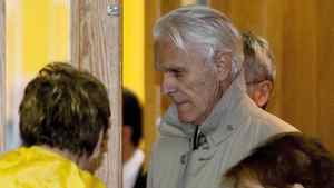 Former judge Jacques Delisle, centre, walks out of a courtroom at his murder trial Tuesday, May 8, 2012 in Quebec City.