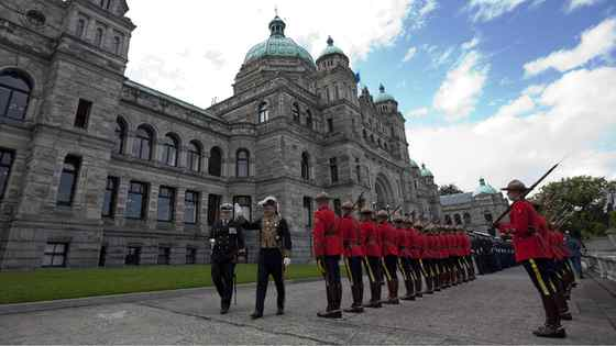 Lieutenant Governor Steven Point waves to the crowd as he inspects the honor guard prior to delivering the Speech from the Throne at the Legislature in Victoria, B.C. Monday, Oct. 3, 2011.