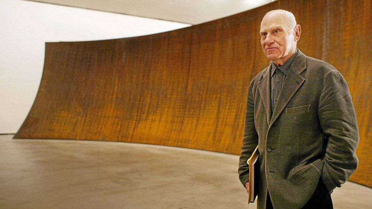 """U.S. sculptor Richard Serra poses in front of """"The Matter of Time,"""" his work featured at the Guggenheim Bilbao Museum."""