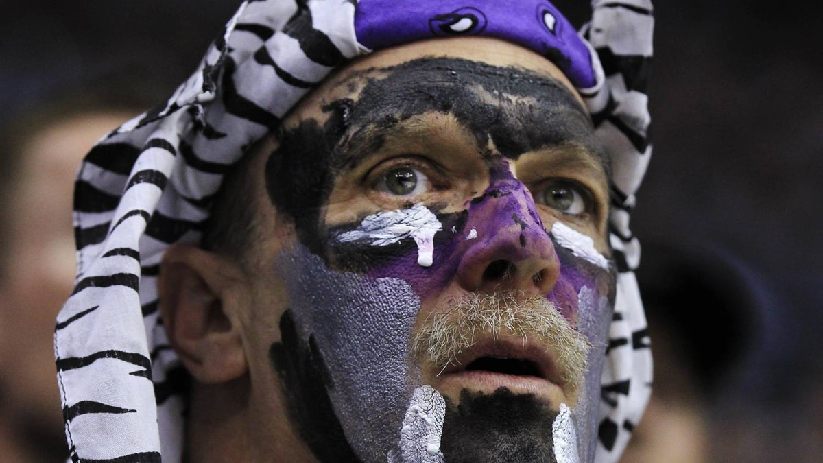 A Los Angeles Kings fan watches the game against the St. Louis Blues during Game 3 of their NHL Western Conference semi-final playoff hockey game in Los Angeles, California May 3, 2012. REUTERS/Lucy Nicholson