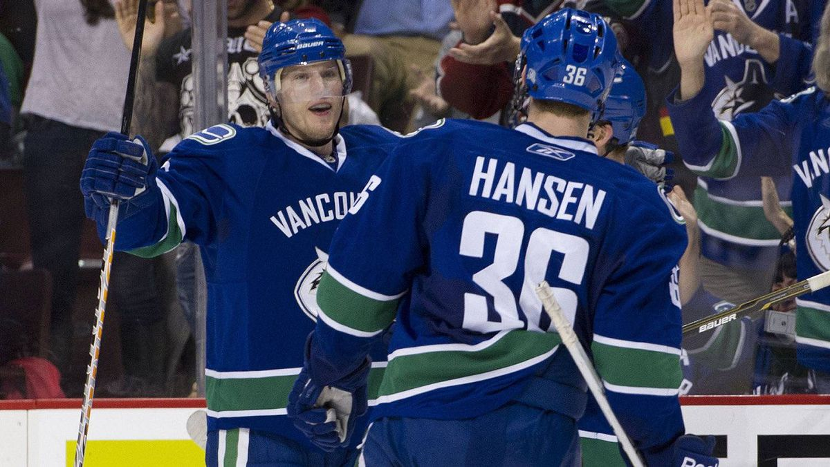 Christian Ehrhoff #5 of the Vancouver Canucks celebrates with teammate Jannik Hansen #36 after scoring against of Los Angeles Kings during the second period in NHL action on March 31, 2011 at Rogers Arena in Vancouver, BC, Canada.