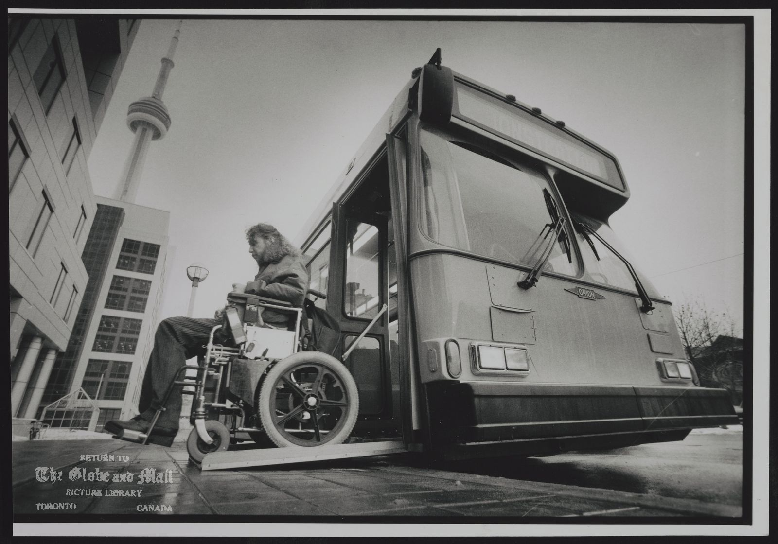 The notes transcribed from the back of this photograph are as follows: THE ENTRANCE OF NEW STEPLESS BUS BEING MANUFACTURED IN MISSISSAGUA