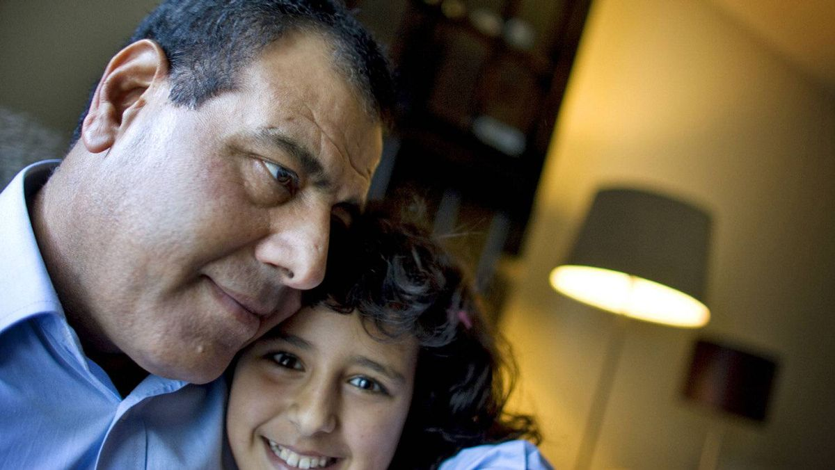 Izzeldin Abuelaish hugs his youngest daughter, Raffah, at his home in Toronto in September of 2009. In January of that year three of his daughters and a niece were killed by an Israeli air strike in Gaza.
