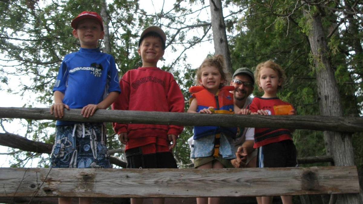 Up in the treehouse are Krista LaRiviere's husband, children,and their cousins.