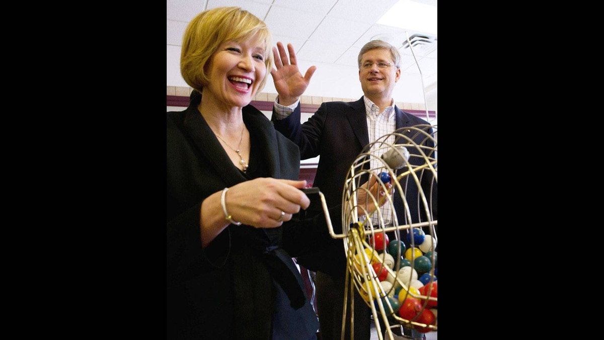 Prime Minister Stephen Harper and Laureen help call bingo at a seniors' residence in Sanit-Hyacinthe Quebec on Sunday, April 10, 2011.