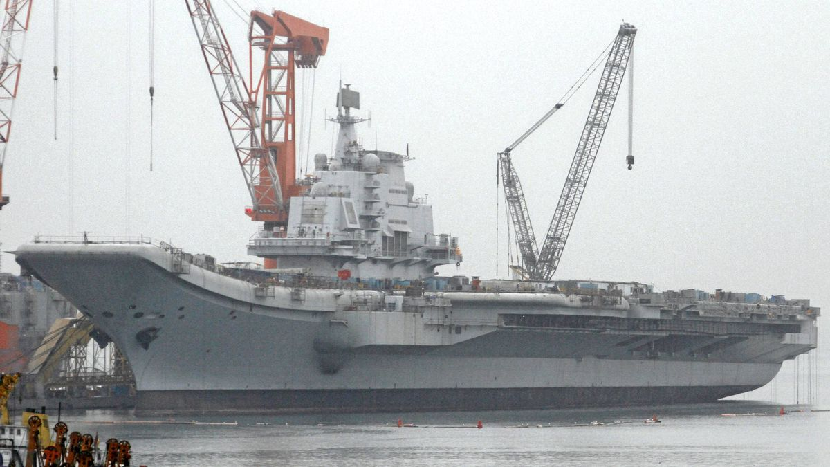 A vessel reported to be the Ukrainian-made aircraft carrier Varyag, which China bought in the 1990s, is seen at a port in Dalian, Liaoning province in this April 17, 2011 file photo. The Indian navy, worried about what it sees as Chinese encirclement at sea, is deepening defence ties with long-term partner Vietnam, and cautiously stepping up its presence in the South China Sea, whose mineral and gas resources are claimed by six countries, including China.