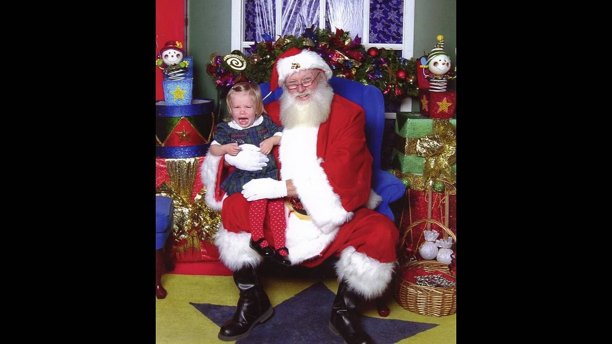 """Kirsten Keil-Mehlenbacher photo: Scared of Santa - Our daughter waited 45 minutes to meet Santa, entertaining the line up with her eagerness - shouting """"Hi Santa!"""", waving to him constantly. When she finally met him, this was the result... poor thing!"""