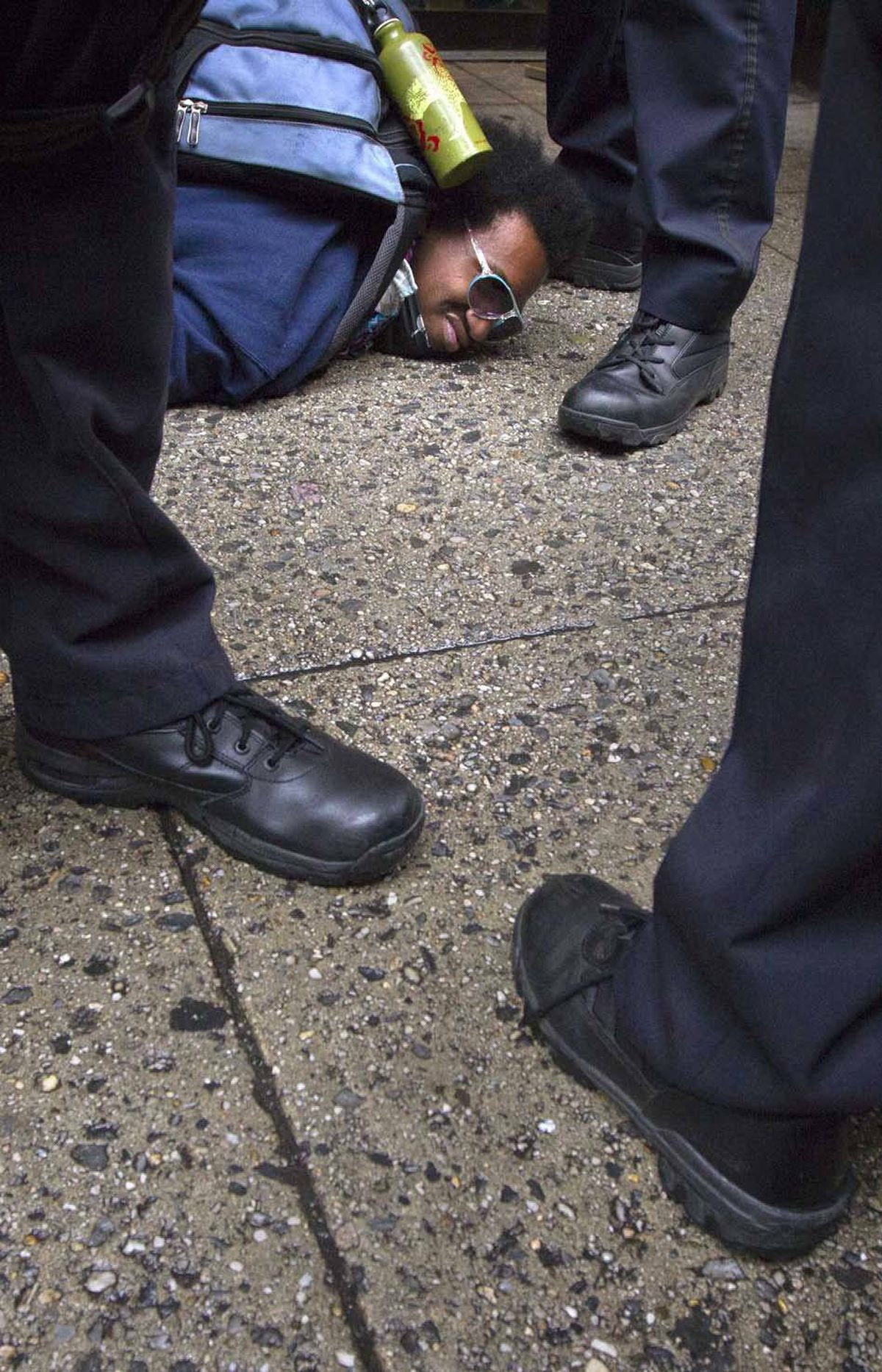 An Occupy Wall Street activist, seen here talking to some police officers during a May Day march in Manhattan on Tuesday, is relieved to hear George Clooney had a good time at the White House Correspondant's dinner in Washington, D.C., on Saturday.