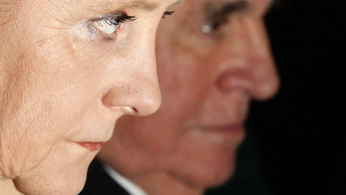 German Chancellor Angela Merkel and her predecessor Helmut Kohl during a reception in Berlin in 2007.