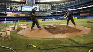 Grounds crew members Jeff Klesc, left, and Jason McDonald prepare the pitcher's mound at the Roger Centre in Toronto Thursday, 31, 2011. The Blue Jays open up their 2011 season against the Minnesota Twins at the Rogers Centre Friday, April 1. THE CANADIAN PRESS/Darren Calabrese