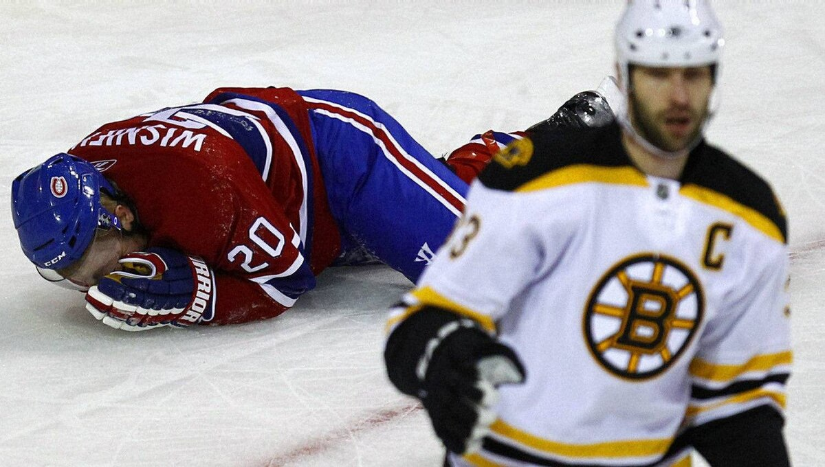 Montreal Canadiens defenseman James Wisniewski (20) reacts after being hit by Boston Bruins defenseman Zdeno Chara (33) during the first period in Game 3 of their NHL Eastern Conference quarter-final hockey game in Montreal, April 18, 2011. REUTERS/Shaun Best