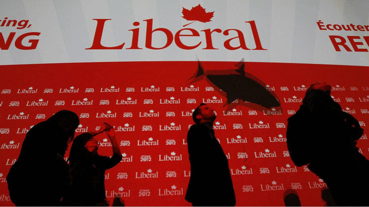 The shadow of small remote controlled shark, with presidential candidate Mike Crawley's name written on it, flies above the heads of delegates line up to cast their ballots for the new executive on day two of the Liberal Convention.
